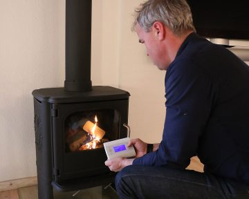 Rekindling the Fireplace Without Living Room Smoke Particles